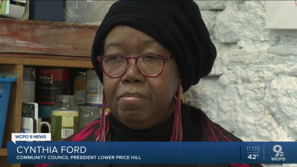 A close-up picture of the face of Lower Price Hill Community Council President, Cynthia Ford, as she is being interviewed by WCPO news.